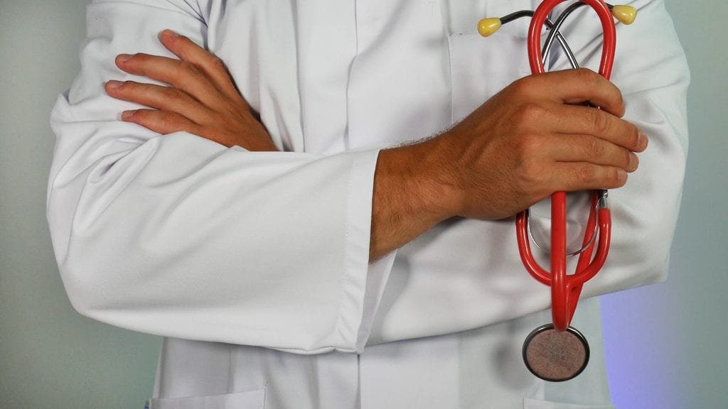 doctor holding red stethoscope