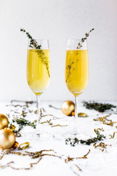 shallow focus photography of champagne glasses surrounded by gold baubles